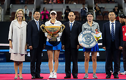 October 7, 2018 - Caroline Wozniacki of Denmark & Anastasija Sevastova of Latvia pose with their trophies after the final of the 2018 China Open WTA Premier Mandatory tennis tournament (Credit Image: © AFP7 via ZUMA Wire)