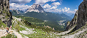 See Monte Pelmo (3169 meters or 10,397 feet) along the hike to Lake Coldai on Monte Civetta, starting from Alleghe village's lift, in the Dolomites, Belluno province, Veneto region, Italy. Upward cables lift supplies to Rifugio Coldai. The Dolomites or Dolomiti are part of the Southern Limestone Alps in Europe. UNESCO honored the Dolomites as a natural World Heritage Site in 2009. This panorama was stitched from 8 overlapping photos.