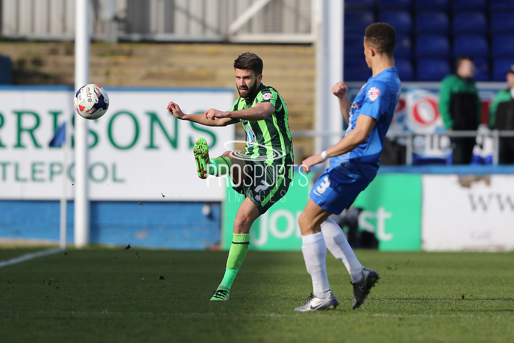 George Francomb midfielder for AFC Wimbledon (7) sends the ball down the wing during the Sky Bet League 2 match between Hartlepool United and AFC Wimbledon at Victoria Park, Hartlepool, England on 25 March 2016. Photo by Stuart Butcher.