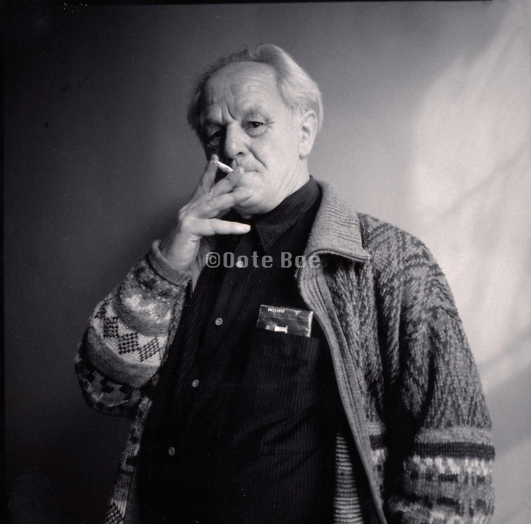 elderly man smoking a cigarette.