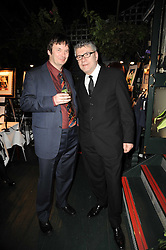 Left to right, writer IAN RANKIN and artist JACK VETTRIANO at the Johnnie Walker Blue Label great Scot Award 2010 in association with The Spectator and Boisdale held at Boisdale of Belgravia, 22 Ecclestone Street, London SW1 on 24th February 2010.