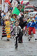 The skeleton king leads a procession through the historic city during the week long fiesta of the patron saint Saint Michael September 24, 2017 in San Miguel de Allende, Mexico.