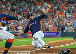 April 29, 2018 - Houston, TX, U.S. - HOUSTON, TX - APRIL 29:  Houston Astros catcher Max Stassi (12) slides onto home plate in the bottom of the seventh inning during the baseball game between the Oakland Athletics and Houston Astros on April 29, 2018 at Minute Maid Park in Houston, Texas.  (Photo by Leslie Plaza Johnson/Icon Sportswire) (Credit Image: © Leslie Plaza Johnson/Icon SMI via ZUMA Press)