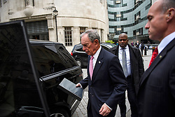 © Licensed to London News Pictures. 19/05/2016. London, UK. Former mayor of New York, Michael Bloomberg (centre) leaves BBC Broadcasting House in London, after commenting on the UK referendum on EU membership during a Radio 4 interview. Photo credit: Ben Cawthra/LNP
