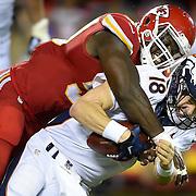 Kansas City Chiefs outside linebacker Justin Houston (50) sacked Denver Broncos quarterback Peyton Manning (18) on Thursday, September 17, 2015 at Arrowhead Stadium in Kansas City, Mo.