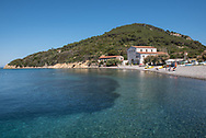 Panorama of Capo Enfola with beach and ancient tuna fishing nets_laboratory, now headquarters of the Tuscan Archipelago National Park