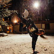 Justus Stearns pulls a handstand beer grab and consume during the last Hostel X team practice.