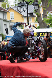Charlie Swordson on stage to get his Best of Show award for his 1970's Harley-Davidson Shovelhead chopper at the Twin Club's annual Custom Bike Show in Norrtälje, Sweden. Saturday, June 1, 2019. Photography ©2019 Michael Lichter.