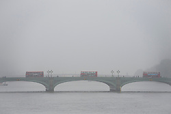 © London News Pictures. 22/10/2012. London, UK.  Red London busses crossing Fog covered Westminster Bridge in Westminster, central London on October 22, 2012 . Photo credit: Ben Cawthra/LNP