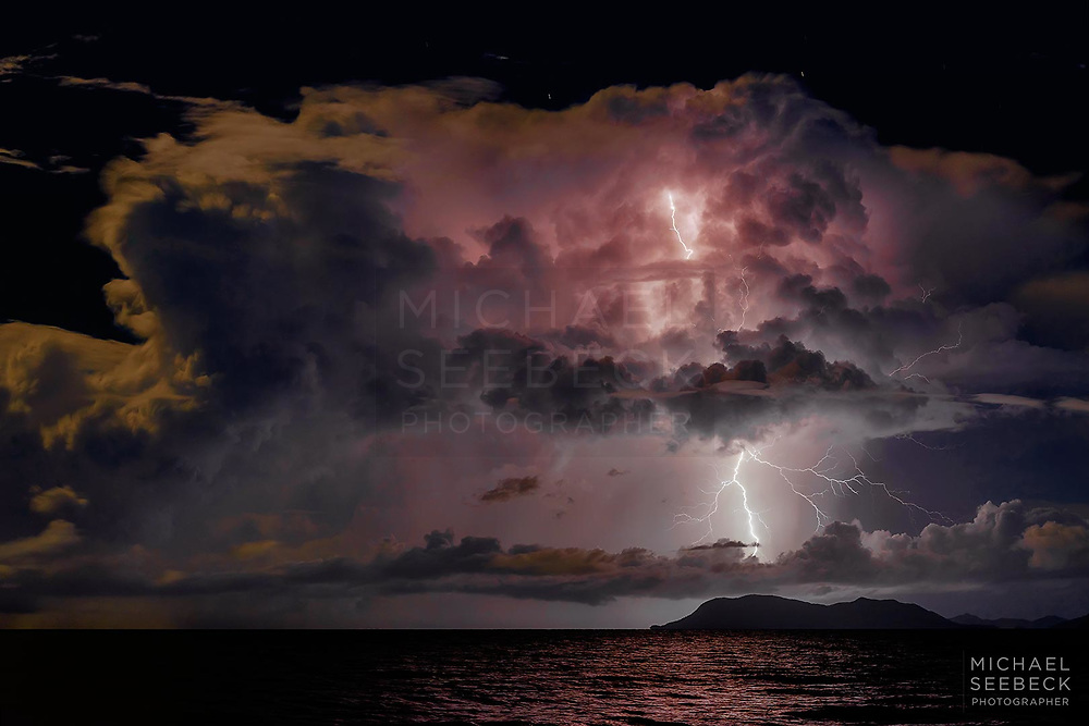 A bolt of lightning strikes the coastline near Yarrabah in full moonlight; captured from the northern beaches of Cairns.<br /> <br /> Code: LAQT0084<br /> <br /> Limited Edition Print