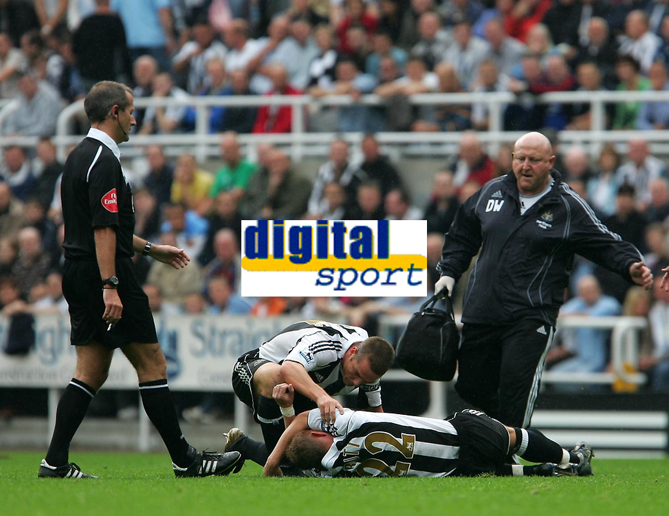 Photo: Andrew Unwin.<br />Newcastle United v Wigan Athletic. The Barclays Premiership. 19/08/2006.<br />Newcastle's Scott Parker checks on Nicky Butt (#22) as he lies injured.