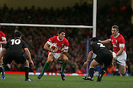 James Hook of Wales looks to go past Dan Carter (10 and Keven Mealamu (2). ).Invesco Perpetual series 2008 autumn international match, Wales v New Zealand at the Millennium Stadium on Sat 22nd Nov 2008. pic by Andrew Orchard, Andrew Orchard sports photography,