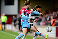 Scunthorpe United Aaron Jarvis (19) Forest Green Rovers Dominic Bernard (3) battles for possession during the EFL Sky Bet League 2 match between Scunthorpe United and Forest Green Rovers at the Sands Venue Stadium, Scunthorpe, England on 16 October 2021.