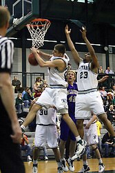 30 December 2006: Andrew Freeman reels in a rebound. The Titans outscored the Britons by a score of 94-80. The Britons of Albion College visited the Illinois Wesleyan Titans at the Shirk Center in Bloomington Illinois.<br />