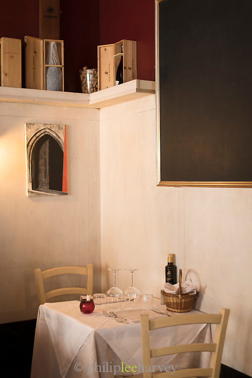 Interior of Hostaria Malcanton with table and chairs ready for guests, Trieste, Italy