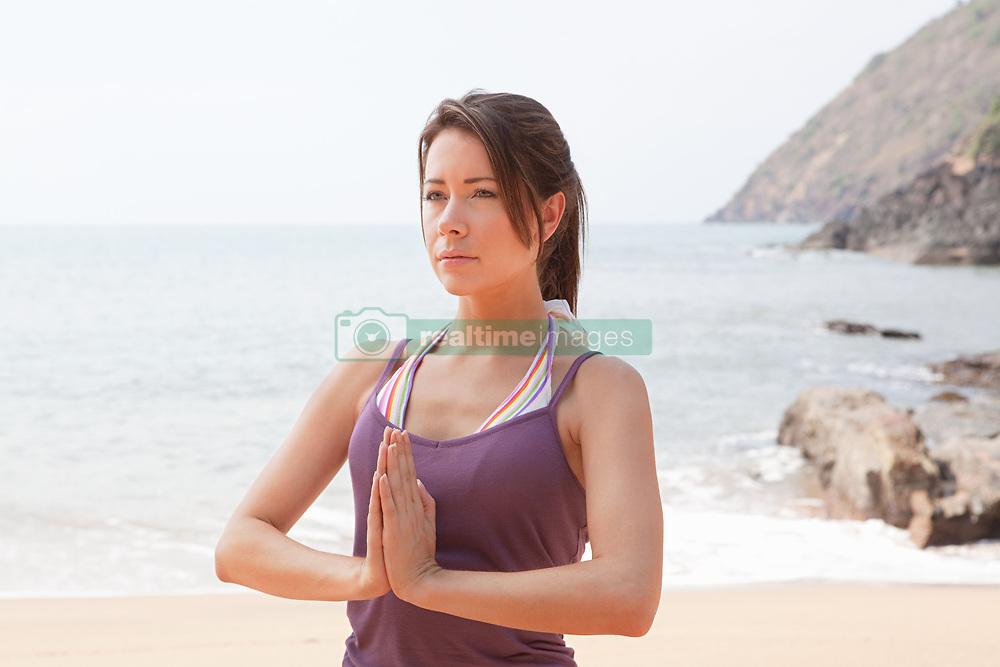 Jul. 25, 2012 - Woman in prayer pose (Credit Image: © Image Source/ZUMAPRESS.com)