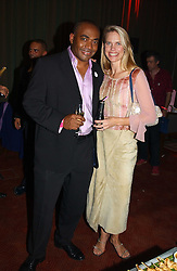 Newsreader DARREN JORDAN and TV presenter ANNA WALKER at the Pink Ribbon Party - A night of Fashion and Music in aid of 3 cancer charities, Breast Cancer Haven, Cancer Resource Centre and Positive Action on Cancer, held at the Waldorf Hilton Hotel, Aldwych, London on 19th October 2004. <br />