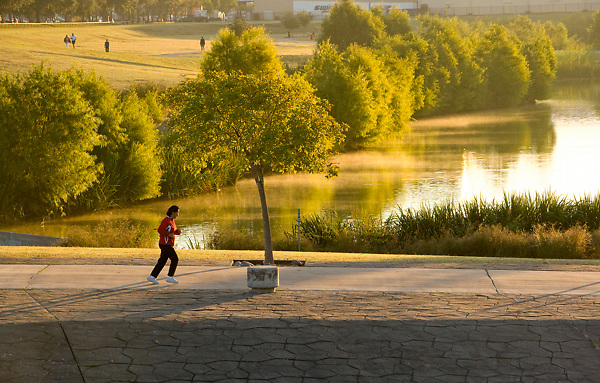 Man jogging along the water at Storey Park in Houston, Texas