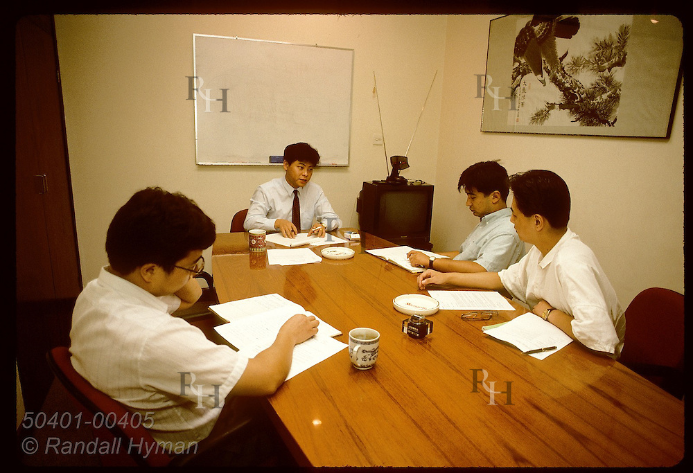 Monsanto rep Sam Chi holds meeting with his Chinese sales staff at corporate office in Shanghai. China