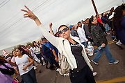 """16 JANUARY 2010 -- PHOENIX, AZ: Alicia Villalba (CQ) from Phoenix, jeers the sheriff during the march. About 10,000 people marched the 2.5 miles from Falcon Park to the """"Tent City"""" on Durango to protest against Maricopa County Sheriff Joe Arpaio and his immigration enforcement tactics. PHOTO BY JACK KURTZ"""
