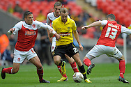 Burton Albion's Adam McGurk © looks to go past  Fleetwood Town's Antoni Sarcevic (l) and Fleetwood Town's  Alan Goodall (r) Skybet football league two play off final match , Burton Albion v Fleetwood Town at Wembley Stadium in  London on Monday 26th May 2014.<br /> pic by John Patrick Fletcher, Andrew Orchard sports photography.