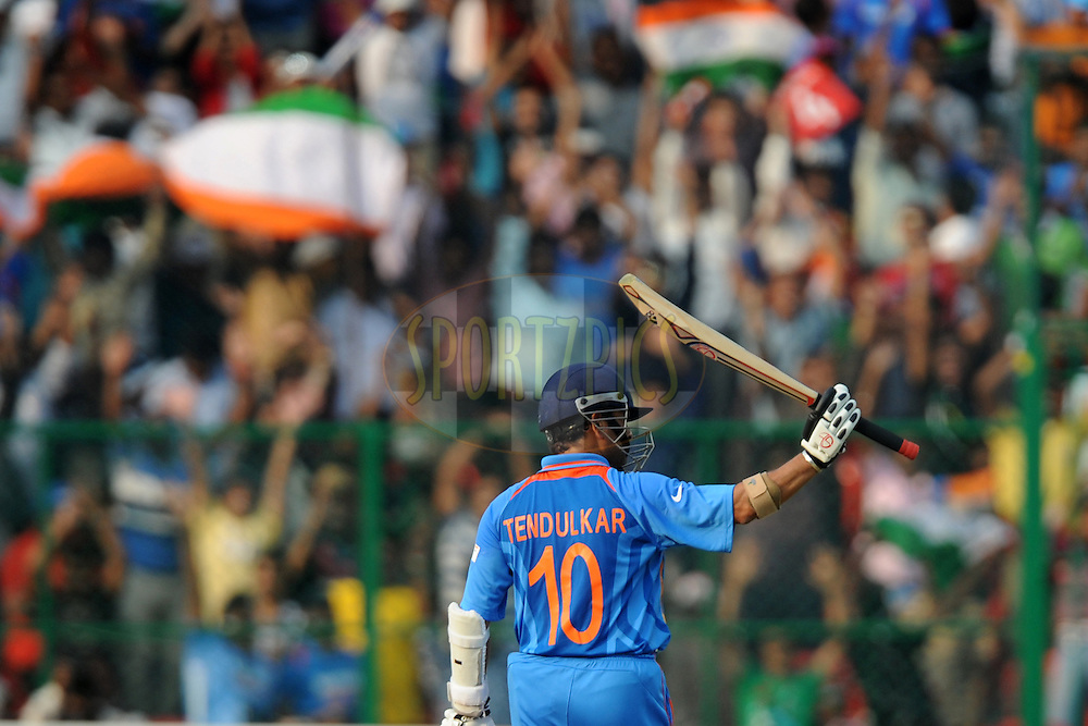 Sachin Tendulkar of India celebrates after hitting a century during the ICC Cricket World Cup match between India and England held at the M Chinnaswamy Stadium in Bengaluru, Bangalore, Karnataka, India on the 27th February 2011..Photo by Pal Pillai/BCCI/SPORTZPICS