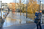 © Licensed to London News Pictures. 03/01/2014. Guildford, UK Guilford town centre River Wey bursting it's banks in Surrey today 3rd January 2013. Floods an heavy rain are continuing to effect travel and people across the country today. Photo credit : Stephen Simpson/LNP