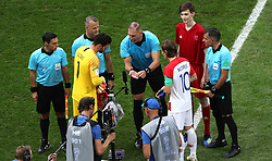 France goalkeeper Hugo Lloris (left), Croatia's Luka Modric and match referee Nestor Pitana during the coin toss prior to the FIFA World Cup Final at the Luzhniki Stadium, Moscow.