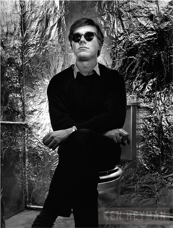Andy Warhol sitting on his silver throne.
