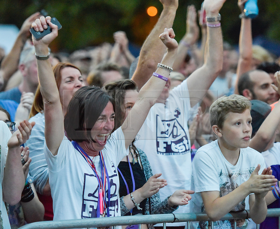 © Licensed to London News Pictures. 27/06/2015. Witney, Oxfordshire. MAUREEN BAKER (mum), PAUL BAKER (dad) and FINLEY BAKER (brother). 3000 attended the very first Lib Fest that took place in memory of Witney schoolgirl Liberty Baker who was killed on the way to school by 18 year old driver Robert Blackwell. PAUL BAKER, the father of Liberty was accused by Police of harassing the Blackwell family and was due in front of magistrates, but it was dropped at the last minute. Photo credit : MARK HEMSWORTH/LNP