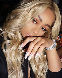 """Blac Chyna releases a photo on Instagram with the following caption: """"Doll Life \ud83d\udc84 @lashedcosmetics !"""". Photo Credit: Instagram *** No USA Distribution *** For Editorial Use Only *** Not to be Published in Books or Photo Books ***  Please note: Fees charged by the agency are for the agency's services only, and do not, nor are they intended to, convey to the user any ownership of Copyright or License in the material. The agency does not claim any ownership including but not limited to Copyright or License in the attached material. By publishing this material you expressly agree to indemnify and to hold the agency and its directors, shareholders and employees harmless from any loss, claims, damages, demands, expenses (including legal fees), or any causes of action or allegation against the agency arising out of or connected in any way with publication of the material."""