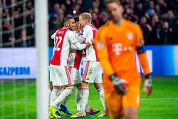 12-12-2018 NED: Champions League AFC Ajax - FC Bayern Munchen, Amsterdam<br /> Match day 6 Group E - Ajax - Bayern Munchen 3-3 / Dusan Tadic #10 of Ajax scores the 1-1 and celebrate Hakim Ziyech #22 of Ajax, Donny van de Beek #6 of Ajax. In the foreground Manuel Neuer #1 of Bayern Munich