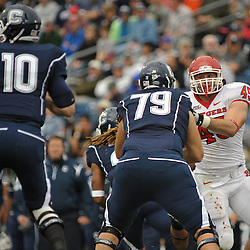 Oct 31, 2009; East Hartford, CT, USA; Connecticut tackle Mike Hicks (79) blocks Rutgers defensive end Alex Silvestro (45) during first half Big East NCAA football action between Rutgers and Connecticut at Rentschler Field.