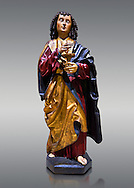 Gothic wooden statue of Sant Joan Evangelista (John the Evangelist) from Gremany, circa 1500, tempera and gold leaf on wood.  National Museum of Catalan Art, Barcelona, Spain, inv no: MNAC  64114. Against a light grey background. .<br /> <br /> If you prefer you can also buy from our ALAMY PHOTO LIBRARY  Collection visit : https://www.alamy.com/portfolio/paul-williams-funkystock/gothic-art-antiquities.html  Type -     MANAC    - into the LOWER SEARCH WITHIN GALLERY box. Refine search by adding background colour, place, museum etc<br /> <br /> Visit our MEDIEVAL GOTHIC ART PHOTO COLLECTIONS for more   photos  to download or buy as prints https://funkystock.photoshelter.com/gallery-collection/Medieval-Gothic-Art-Antiquities-Historic-Sites-Pictures-Images-of/C0000gZ8POl_DCqE