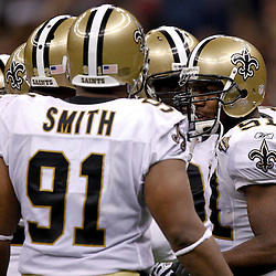 September 9, 2010; New Orleans, LA, USA;  New Orleans Saints linebacker Jonathan Vilma (51) talks to teammates in the defensive huddle during the NFL Kickoff season opener at the Louisiana Superdome. The New Orleans Saints defeated the Minnesota Vikings 14-9.  Mandatory Credit: Derick E. Hingle