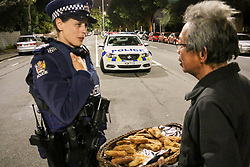March 16, 2019 - Christchurch, Canterbury, New Zealand - Police officer on a long guard shift is offered some comfort food by a member of the Indonesian community after the Christchurch mosques shooting. Around 50 people has been reportedly killed a terrorist attack onn two Christchurch mosques. (Credit Image: © Adam Bradley/SOPA Images via ZUMA Wire)