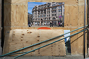 Above construction materials is an illustration showing what a refurbished building will look like when finished on Blomfield Street near Liverpool Street Station in the City of London, the capital's financial district - aka the Square Mile, on 8th August, in London, England. The address at 31–35 Blomfield Street is a modern retail space behind a historic Edwardian facade.