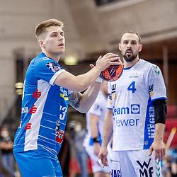Viggo Kristjansson (TVB Stuttgart #73) ; Tim Kneule (FRISCH AUF! Goeppingen #4) ; LIQUI MOLY HBL 20/21  1. Handball-Bundesliga: TVB Stuttgart - FRISCH AUF! Goeppingen am 24.04.2021 in Stuttgart (SCHARRena), Baden-Wuerttemberg, Deutschland,<br /> <br /> Foto © PIX-Sportfotos *** Foto ist honorarpflichtig! *** Auf Anfrage in hoeherer Qualitaet/Aufloesung. Belegexemplar erbeten. Veroeffentlichung ausschliesslich fuer journalistisch-publizistische Zwecke. For editorial use only.
