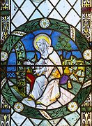 Stained glass window of Saint Anne in church of Saint Margaret, South Elmham, Suffolk, England, UK c 1917