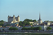 The Chateau de Saumur on the south bank of the Loire in the town Saumur, once inhabited by Anne d'Anjou, as seen from the bridge crossing the river., Maine et Loire, France
