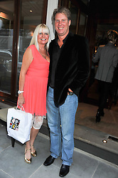 LINDSEY CARLOS CLARKE and her husband ANDREW RAITT at a private view of an exhibition of photographs by Mike Figgis entitled 'Kate & Other Women' held at The Little Black Gallery, 13 A Park Walk, London SW10 on 22nd June 2011.