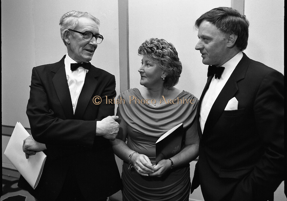 People Of The Year Awards.  (R91)..1988..22.11.1988..11.22.1988..22nd November 1988..This is the fourteenth year of the People of the Year Awards, sponsored by the New Ireland Assurance Company plc. The awards will be presented by Mr Ray Burke TD, Minister of Energy and Communications. Eight people have been nominated this year..Mr Ollie Jennings, for his contribution to community and cultural life of Galway City..Mr Jack Charlton, for restoration of pride to the Irish Soccer team..Ms Carmencita Hederman, For her efforts to instill a community spirit in Dublin..Maureen O'Mahony, for her dedication in assisting the sick and elderly in the Bantry area..Mr Tommy Boyle, for his contribution in having the Garda band ranked as one of the top bands in the world..Ms Alice Leahy, for a lifetime commitment in providing medical care to the Dublin Homeless..Ms Norma Smurfitt, for her voluntary contribution to the work of the Arthritis Foundation Of ireland..Mr Gordon Wilson, for his commitment to peace and reconcilliation in Northern Ireland...Picture shows Mr Gordon Wilson, Mrs Audrey Casey and her husband, Jack, Managing Director, New Ireland.