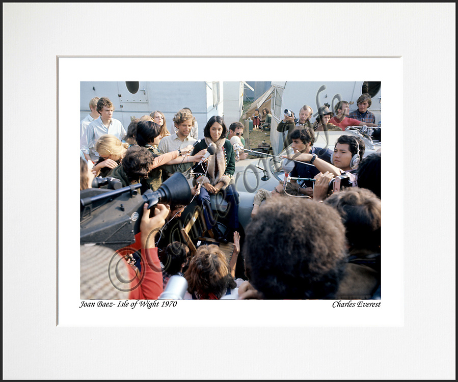 """Joan Baez - An affordable archival quality matted print ready for framing at home.<br /> Ideal as a gift or for collectors to cherish, printed on Fuji Crystal Archive photographic paper set in a neutral mat (all mounting materials are acid free conservation grade). <br /> The image (approx 6""""x8"""") sits within a titled border. The outer dimensions of the mat are approx 10""""x12""""."""