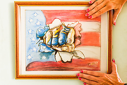 November 27, 2016 - Havana, Cuba - A picture of a painting from the CUban Revolution epoque, seen in Havana on November 26, 2016, the next day after Fidel Castro, Cuba's historic revolutionary leader, and the former Prime Minister and President of Cuba, dies on the late night of November 25, 2016, at age of 90. . Fidel Castro died aged 90. One of the world's longest-serving rulers and modern history's most singular characters, Castro defied 11 US administrations and hundreds of assassination attempts..On Saturday, 25 November 2016, in Havana, Cuba. (Credit Image: © Artur Widak/NurPhoto via ZUMA Press)