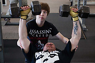 Khalil, 12, spots his father at a gym in Parsons on the morning of March 7, 2013.