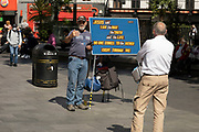 Man preaching the religion of Christianity in Leicester Square on 2nd July 2021 in London, United Kingdom.