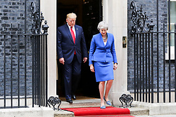 © Licensed to London News Pictures. 04/06/2019. London, UK. President of the United States Donald Trump and British Prime Minister Theresa May leave 10 Downing Street for the Foreign and Commonwealth Office for a joint press conference on the second day of the State Visit. Photo credit: Dinendra Haria/LNP