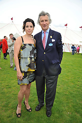 Actress NEVE CAMPBELL and ARNAUD BAMBERGER MD of Cartier at the 25th annual Cartier International Polo held at Guards Polo Club, Great Windsor Park, Berkshire on 26th July 2009.