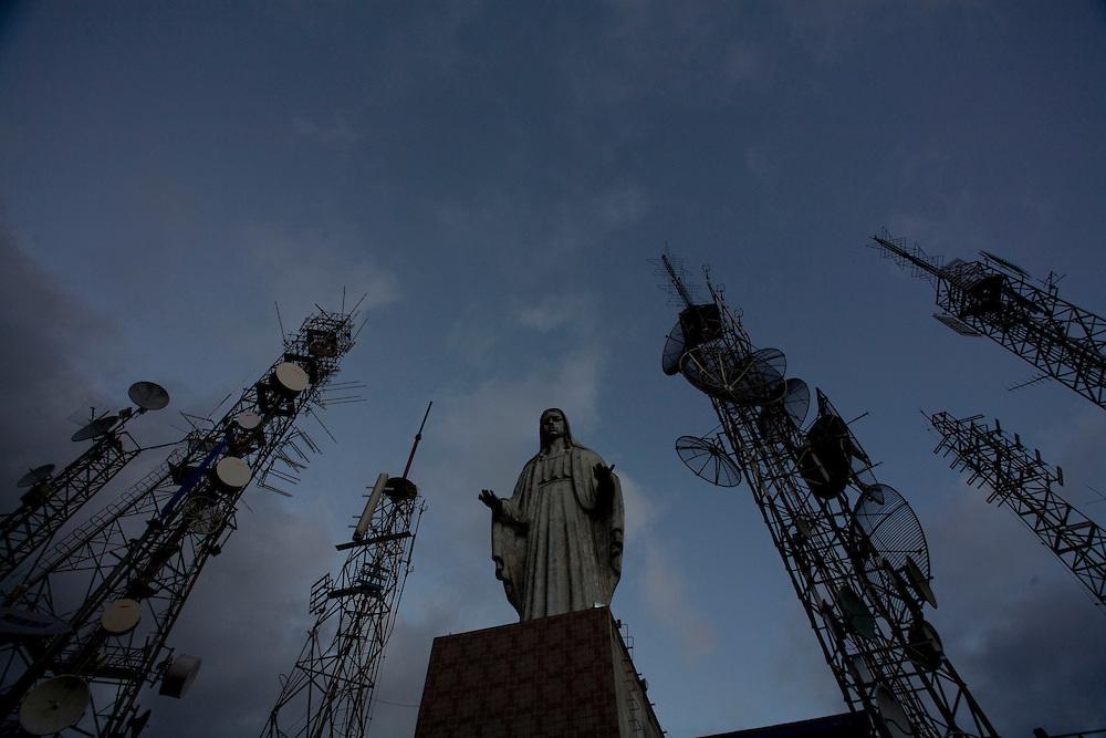 Governador Valadares_MG, Brazil.<br /> <br /> Imagem de Nossa Senhora oprimida pelas estruturas do 4o poder em Govenador valadares, Minas Gerais.<br /> <br /> Image of saint in Govenador Valadares, Minas Gerais.<br /> <br /> Foto: LEO DRUMOND / NITRO