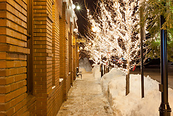"""""""Walkway in Downtown Truckee 2"""" - This icy and snowy walkway was photographed along the Bar of America brick building in Downtown Truckee, California."""